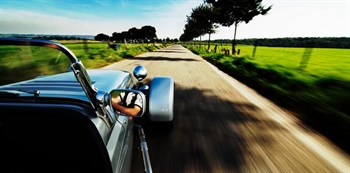 stock-photo-driving-a-sports-car-on-a-road_rev100